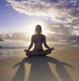 540401Woman-Meditating-on-Beach-Pos